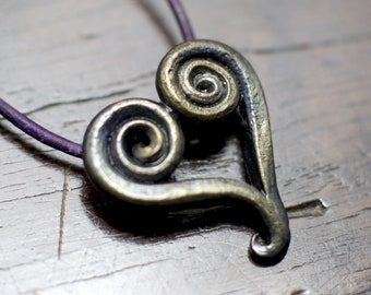 Pure Iron Heart Necklace, a hand forged spiral heart pendant on an adjustable leather or cotton necklace. Gift box included.