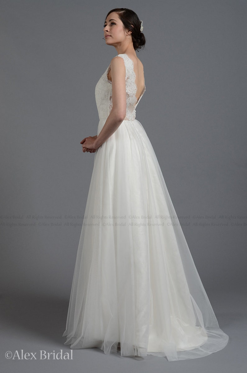 Sleeveless lace wedding dress V-back alencon lace with tulle skirt.