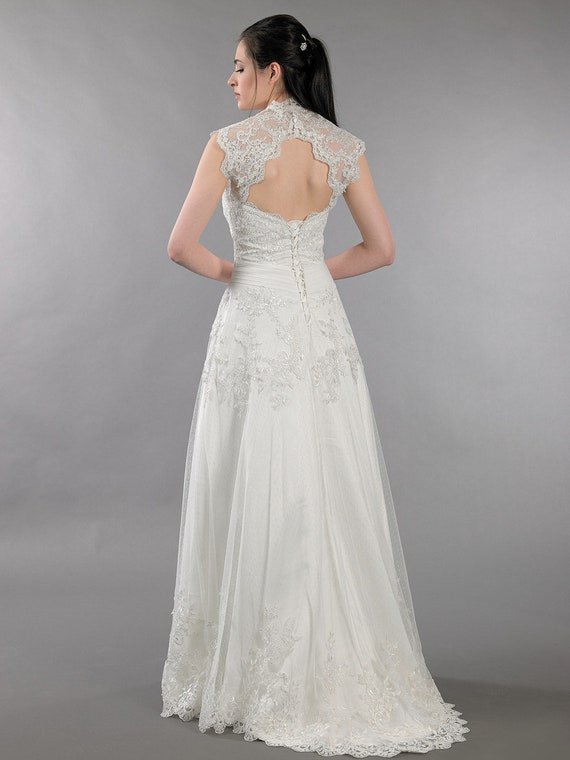 851383aec9 Lace wedding dress with corset back keyhole back bolero