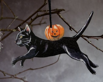 Black cat with a pumpkin, Halloween hanging ornament. Vintage Halloween style decor made from wood