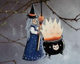 Wooden witch with a cauldron hanging ornament. Halloween decoration, vintage style