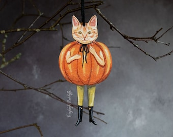 Halloween hanging decoration of a pumpkin cat called Terrance. Made from laser cut printed wood.