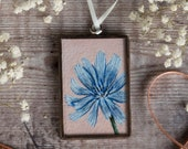 Glass ornament encasing an original painting of a blue cornflower. Hand painted miniature. Summer decor, gift for loved one, Birthday gift.