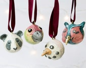 Hand crafted small Christmas tree ornamental baubles. Featuring a panda, parrot, snowman and pheasant bird head. Christmas decorations.