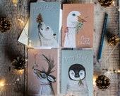 Pack of 4 seasonal Christmas cards- Polar bear, white goose, reindeer, baby penguin. Merry Christmas. Blank note cards.