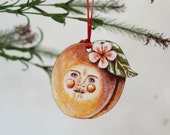 Peachy Pete, an illustrated wooden hanging decoration. Peach hanging decoration, peach art, anthropomorphic fruit, Georgia peach