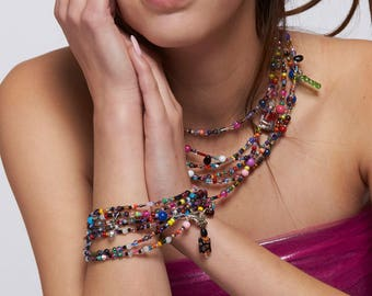 Multi-layered wrap bracelet/necklace. 73.5 inches long.