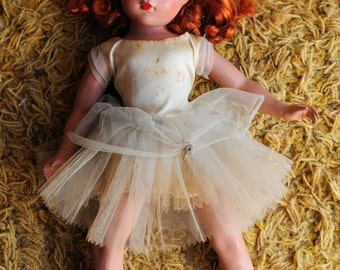 8x10 Signed Archival Photographic Print of a Sleeping Red Haired Doll in White Tutu Dress laying Yellow Mustard Shag Rug Abandoned Dirty