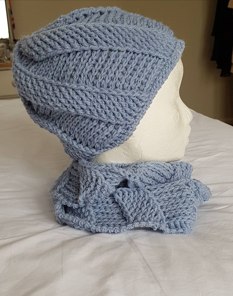 Blue cork-screw patterned matching beanie hat and looped scarf set hand crocheted