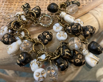 Halloween Bracelet Charm Bracelet with Cats and Skulls and Moon Faces in black white and gold very fun and feels great on! Cat Bracelet Love