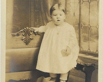 Antique RPPC Real Photo Postcard - Cute Baby Toddler Child - 1918-1930 - Necklace - White Dress - Standing on Bench