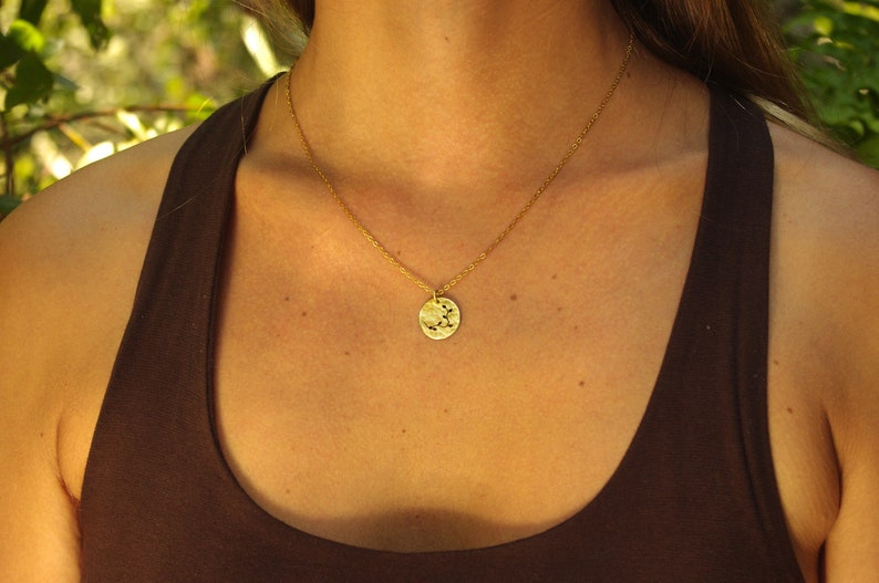 round small brass pendant with filigree motif in gift box