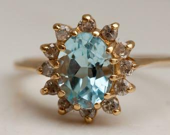 Vintage Aquamarine and diamond 14k Yellow Gold Halo ring, Size 5.25