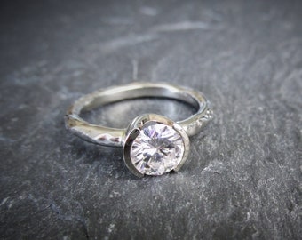Rugged Solitaire Engagement Ring with Half Bezel Forever One Colorless Moissanite in recycled eco friendly gold. Made To Order