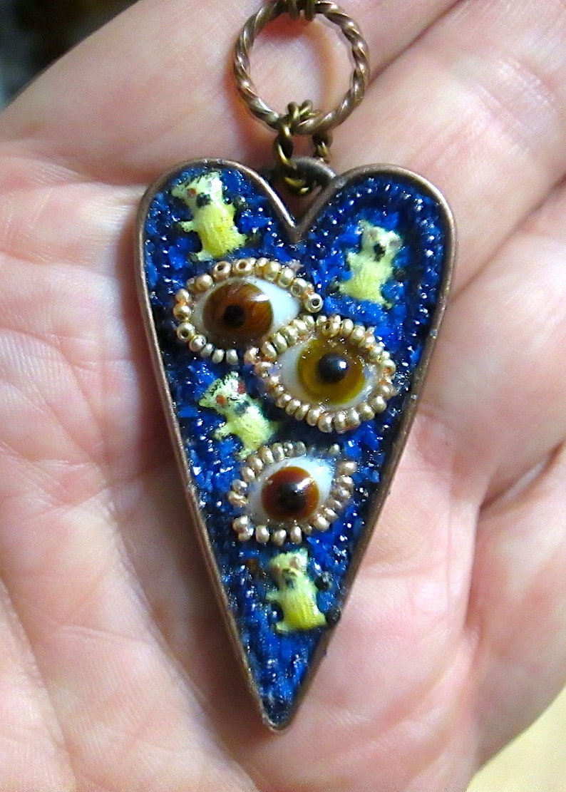 unique glass bead in a custom copper setting The Heart/'s Eye