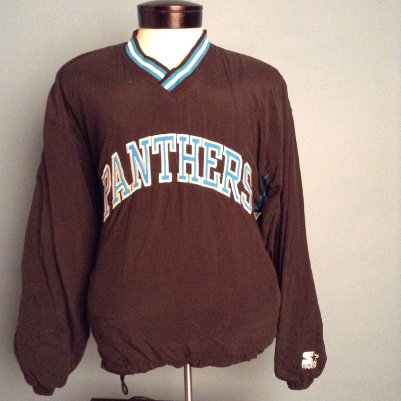 first rate 8e6c7 cfdb6 Vintage Carolina Panthers Starter Reversible Jacket