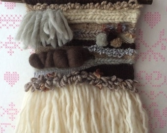 Woven wall hanging cream brown grey pompon