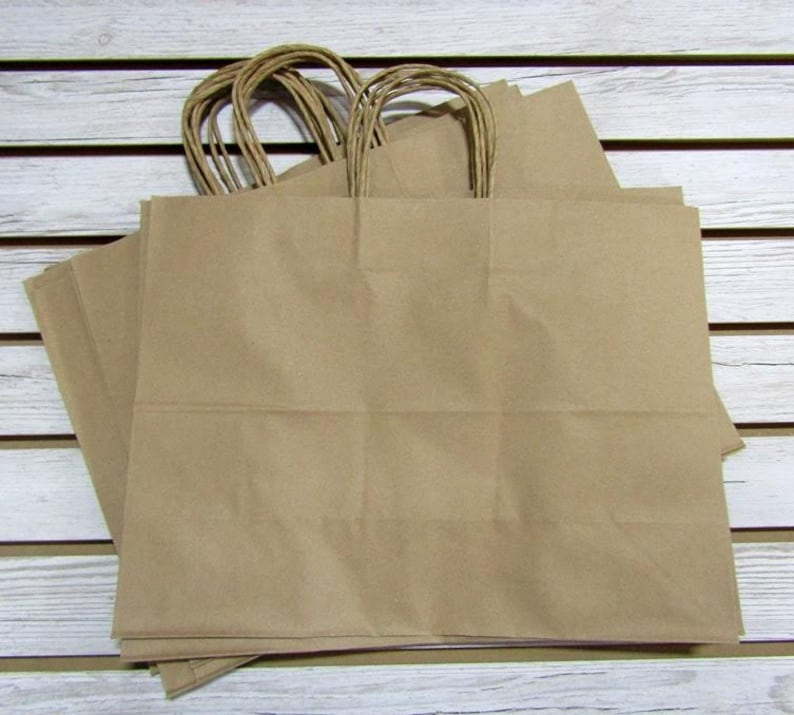 Gift bags 8X4X10  HANDLES NEW LOT OF 50 Newsprint Paper Paper Shopping
