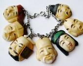 Vintage 40s Toshikane Japanese Carved Faces Seven Lucky Gods of Fortune Charm Bracelet