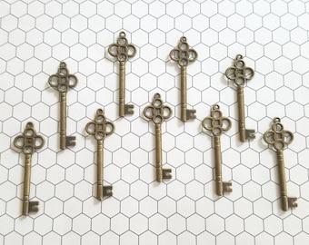 Set of 9 (nine) Vintage Inspired Bronze Skeleton Key Charm Pendants 45x15mm Necklace Charms