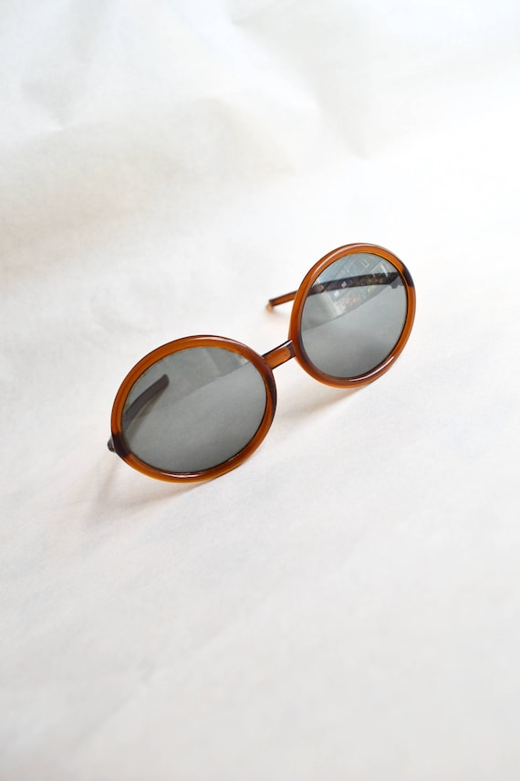 9e6c7defa0 1970s Polaroid bug eye rootbeer sunglasses   70s brown large