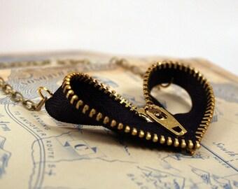 Zipper Heart Pendant - Black and Gold Zipper Heart Pendant Hangs from Medium Length Gold Chain
