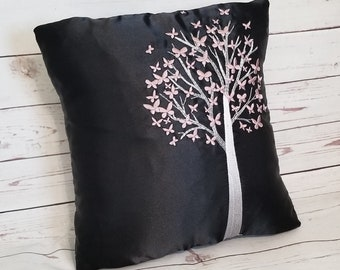 Mauve Pink colored Butterflies fluttering around a white Tree embroidered black satin pillow, sophisticated minimalist, black & white pillow