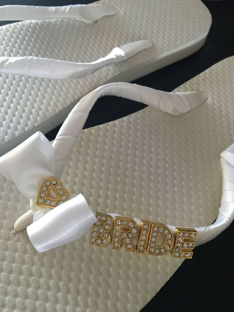 96d856da2f789 BRIDE flip flops Gold Letters and a Heart bow