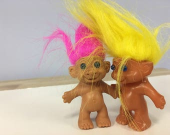 Two Small Treasure Troll Dolls with Pink and Yellow Hair