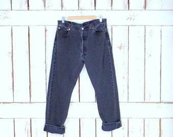 Vintage faded black denim 501 button fly jeans/high waisted straight leg jeans/faded Levi Strauss jeans