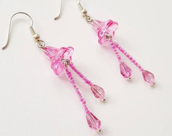 delicate pink glass earrings with flower