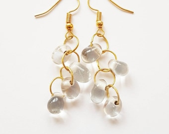 playful goldtone earrings with clear glass drops