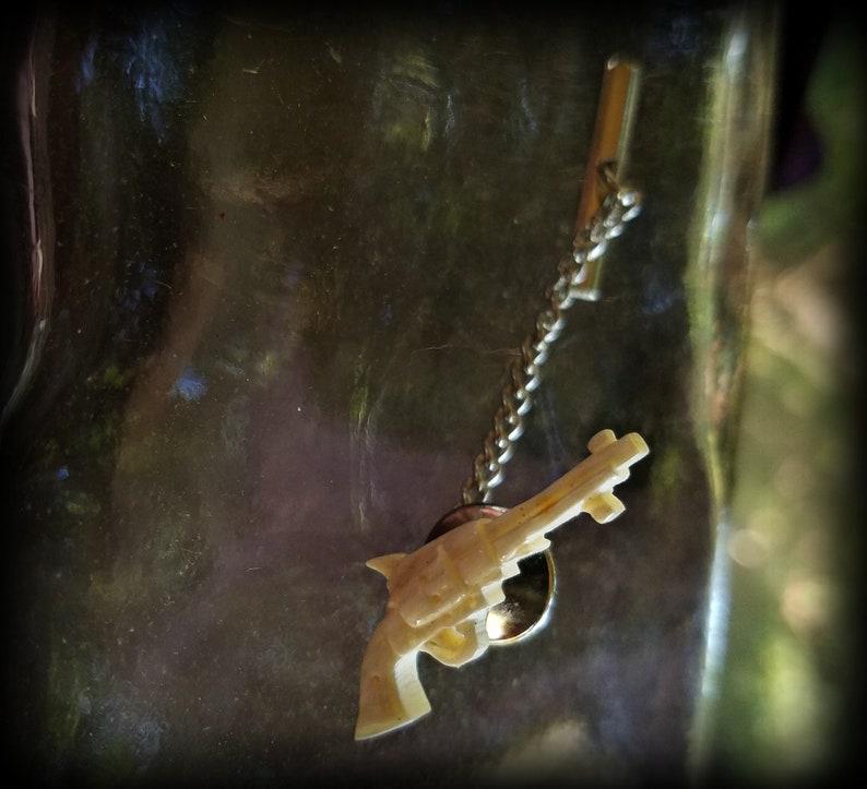 Vintage Carved Bone Revolver Tie Pin