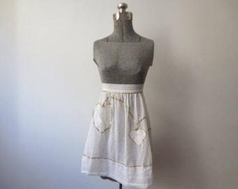 Vintage '50s Nearly Sheer White Half Apron w/ Gold Ric Rac Trim & Asymmetrical Heart Detail