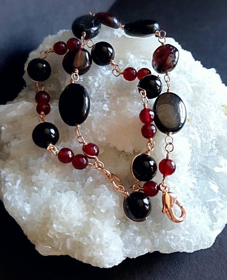 Multi Strand  Black Onyx Cats Eye And Garnet Wire Wrapped in image 0