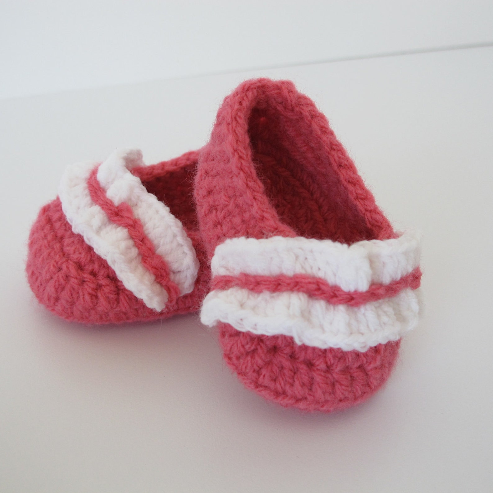 baby's first ballet shoes in bright coral with a white ruffle