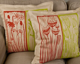 handprinted cushion covers in red and lime green on beige with my own linocuts on linen fabric, birds, plants, flowers,