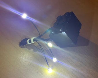 4x White LED light for LEGO creation. Small enough to fit in any LEGO piece