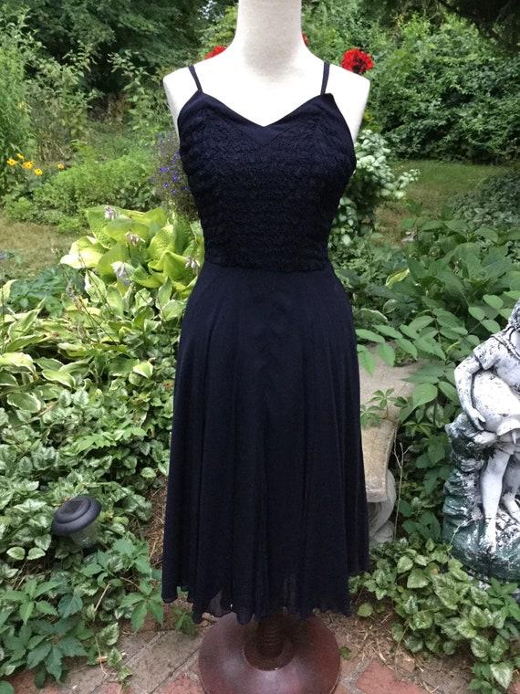 1950s dark navy dress in sleek silk with smoking s