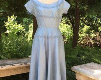 What will you keep in the POCKETS of this sky blue raw silk 1940s frock?