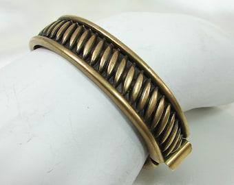 Monet Hinged Clamp Bracelet Antiqued Gold Tone