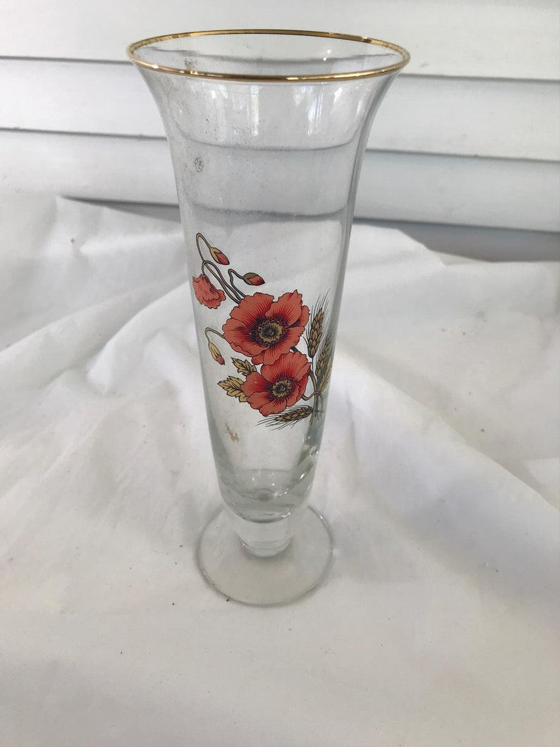 Glass trumpet vase with orange flowers