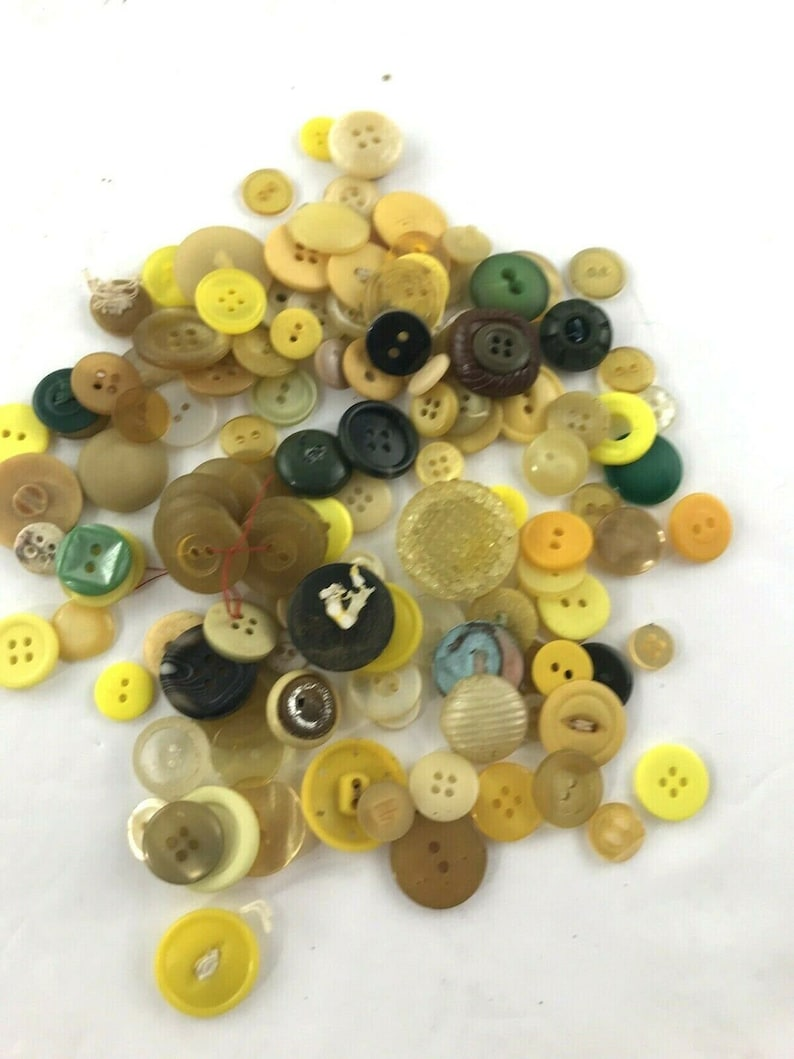 Yellow and brown button assortment craft embellishment
