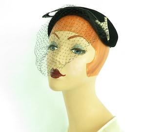 Woman's black hat, vintage 1950s cocktail hat, velvet with feather, rhinestones.