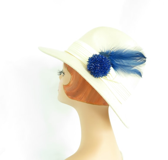 White fedora hat, vintage 1970s, blue feather and