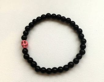 Black Stretch Bracelet with Pink Skull