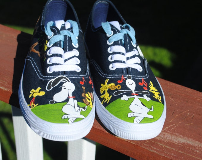 Dancing Snoopy and Friends done on Navy size 6 - sold