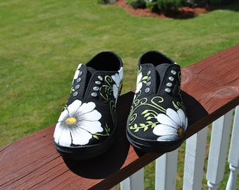 For Sale Super Cute black slip on (no laces) cyrstals instead, with pretty daisies and swirls size 5 READY TO SHIP