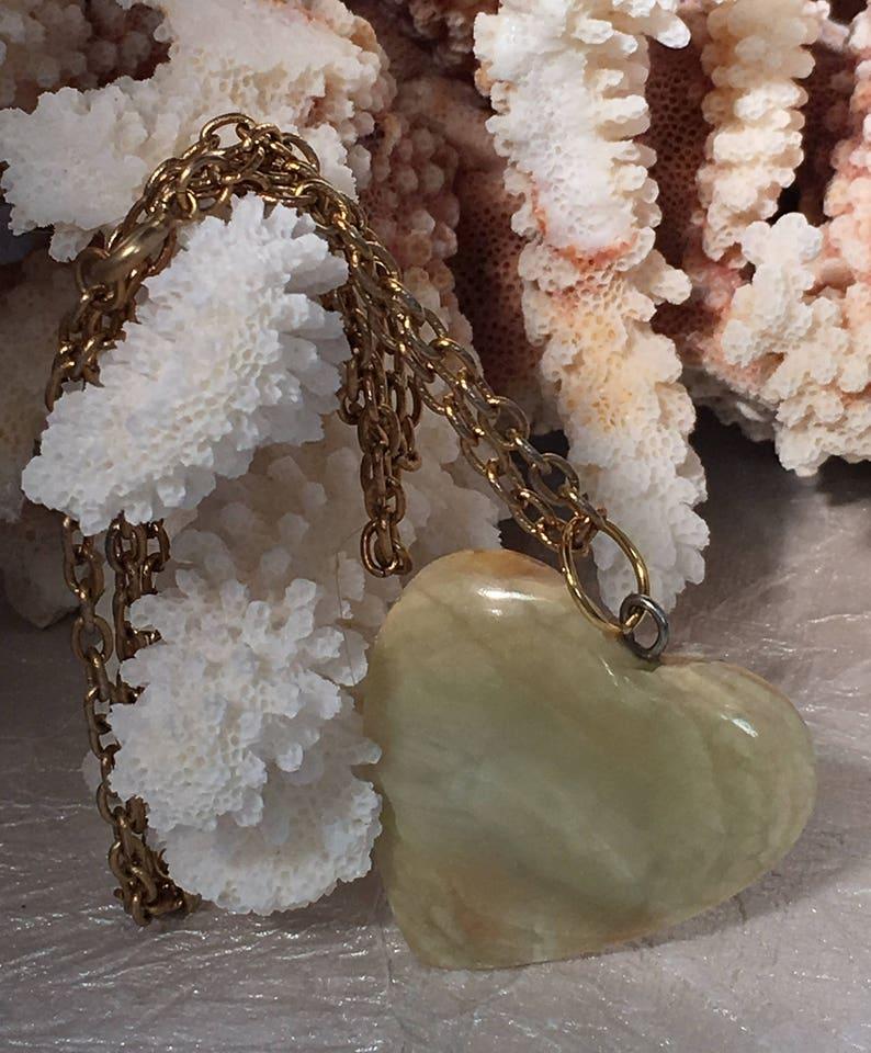 Wonderful Jasper Heart on a 24 inch gold tone necklace .