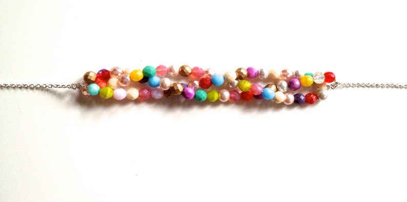 A beautiful statement necklace of sparkling beads to add color and style to any outfit Triple Strand Twist Czech Glass Beaded Necklace